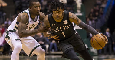 Nets guard D'Angelo Russell drives to the basket around Milwaukee Bucks guard Eric Bledsoe on April 5, 2018, at BMO Harris Bradley Center in Milwaukee, Wisconsin.