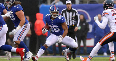 Giants running back Saquon Barkley looks for running room against the Chicago Bears on Dec. 2, 2018, at MetLife Stadium.