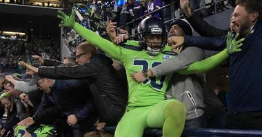 Seahawks strong safety Bradley McDougald celebrates with fans after a touchdown in the fourth quarter against the Minnesota Vikings on Dec. 10, 2018, at CenturyLink Field in Seattle.
