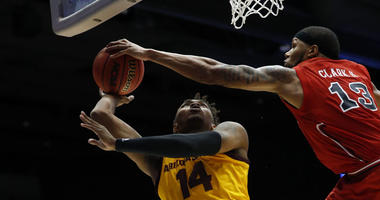 St. John's forward Marvin Clark II (13) blocks a shot from Arizona State forward Kimani Lawrence (14) in the First Four of the NCAA Tournament on March 20, 2019, in Dayton, Ohio.