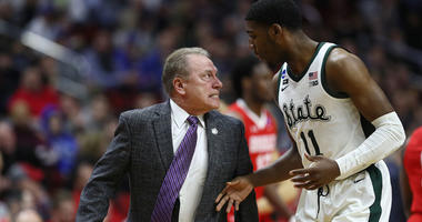 Michigan State coach Tom Izzo glares at Aaron Henry after a play during their game in the first round of the NCAA tournament against Bradley on March 21, 2019, in Des Moines, Iowa.