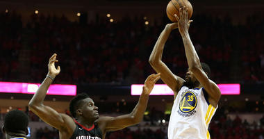 The Warriors' Kevin Durant shoots over the Rockets' Clint Capela during Game 7 of the Western Conference finals on May 28, 2018, at Toyota Center in Houston.