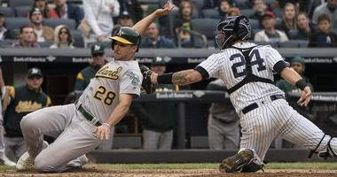 Yankees catcher Gary Sanchez tags out Oakland Athletics first baseman Matt Olson attempting to score on a sacrifice fly on May 12, 2018, at Yankee Stadium.