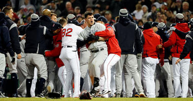 The Yankees Tyler Austin is held back during a scrum against the Red Sox on April 11, 2018, at Fenway Park in Boston.