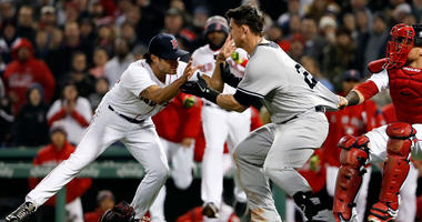 The Yankees' Tyler Austin starts a fight with Boston Red Sox pitcher Joe Kelly (56) during the seventh inning on April 11, 2018, at Fenway Park.