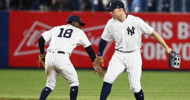 New York Yankees shortstop Didi Gregorius and New York Yankees right fielder Aaron Judge celebrate after defeating the Minnesota Twins at Yankee Stadium on Apr 24, 2018.