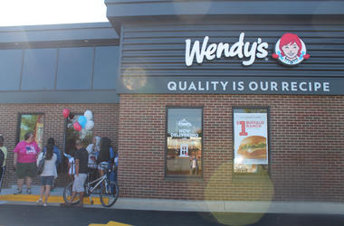 Jen Richer and the 94.7 Fresh FM Street Team interact with fans at the grand re-opening of the Wendy's in Germantown.