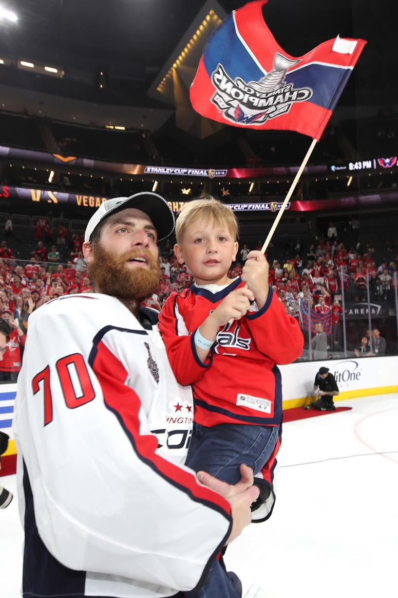 Braden Holtby #70 of the Washington Capitals celebrates with his son