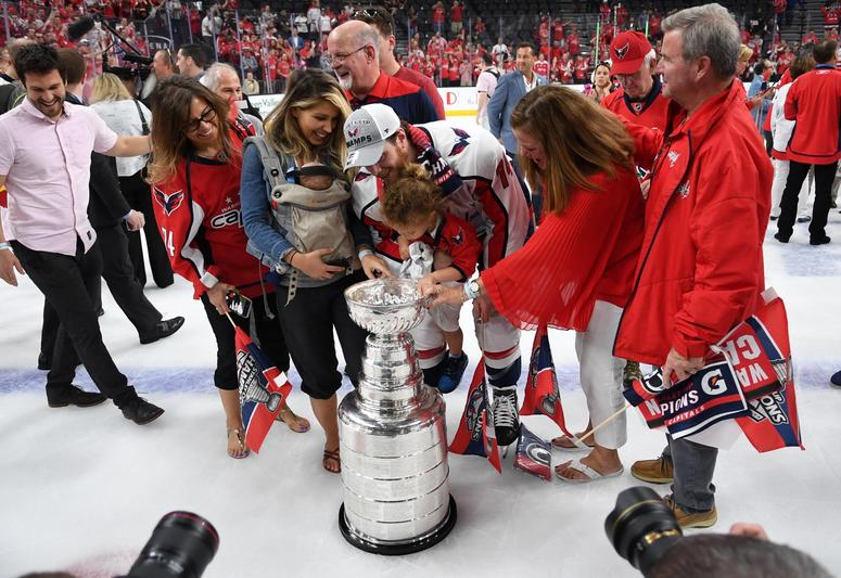 Washington Capitals defenseman John Carlson (74) and family celebrate with the Stanley Cup after defeating the Vegas Golden Knights
