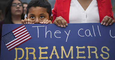 Sep 5, 2017; Greenvill, SC, USA; Esvin Sosa, 7, stands with his mom at a vigil for Dreamers in response to Trump's announcement to end DACA outside of the Peace Center.