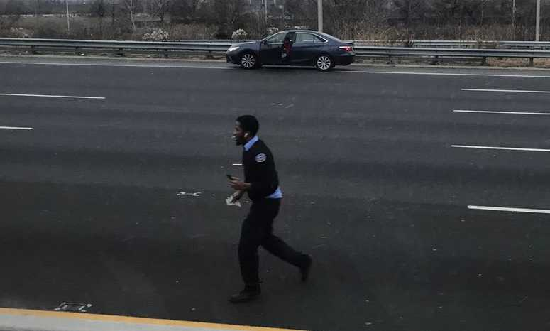 Drivers chase cash that fell from a Brink's security truck on Route 3 in East Rutherford.