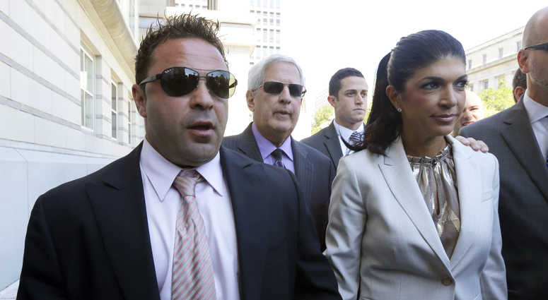 """The Real Housewives of New Jersey"" stars Giuseppe ""Joe"" Giudice, left, and his wife, Teresa Giudice, walk out of Martin Luther King Jr. Courthouse"