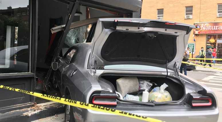 Four people were injured when a car slammed into a Bed Stuy building.