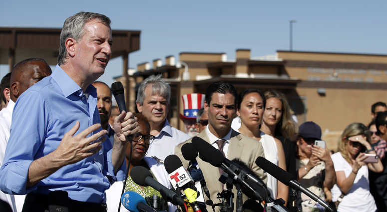 New York Mayor Bill de Blasio speaks alongside a group of other U.S. mayors during a news conference outside a holding facility for immigrant children in Tornillo, Texas, near the Mexico border.