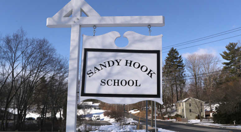 A sign stands near the site of the December 2012 Sandy Hook school shooting