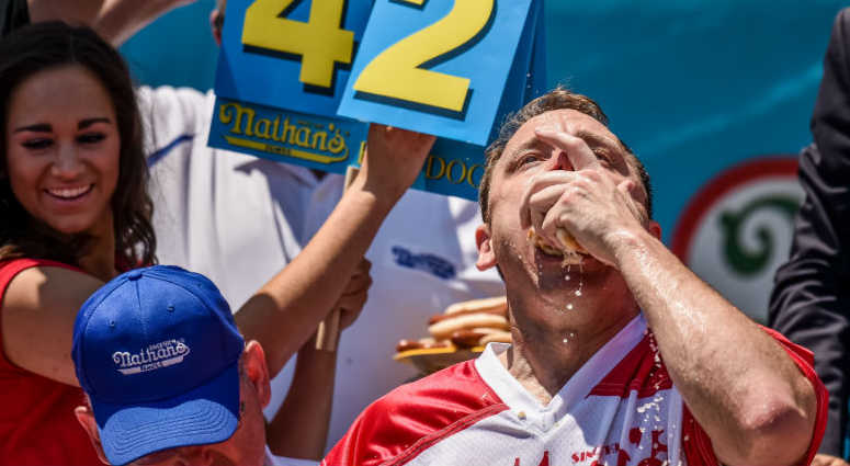 """Joey """"Jaws"""" Chestnut competes in Nathan's Famous 101th Anniversary of the 4th of July hot dog-eating contest at Coney Island."""