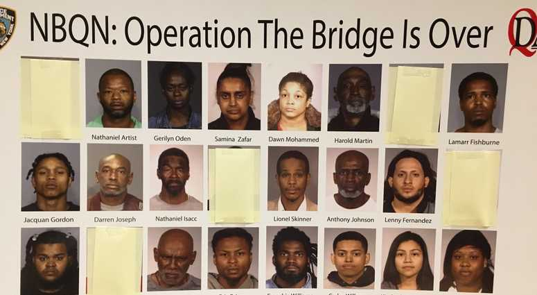 Twenty-two alleged gang members were arrested in a raid at the Queensbridge Houses.