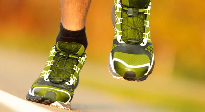 File image feet in running shoes.