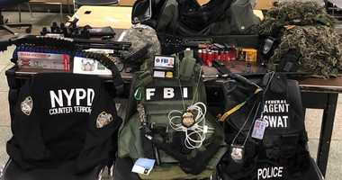 Police say they found a cache of weapons, ballistic vests, and law enforcement IDs during a raid in Queens.