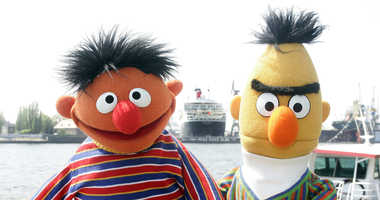 "In this May 9, 2006, file photo, Ernie and Bert of ""Sesame Street"" pose in front of the Queen Mary II in the harbor of Hamburg, Germany."