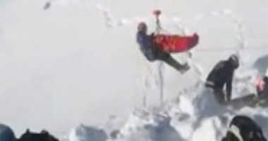 In this grab taken from validated UGC provided on Thursday, Dec. 27, 2018, a boy is airlifted after an avalanche, on the French Alps on Wednesday.
