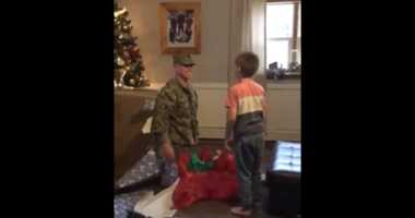 WATCH: Military dad returns, surprises son by hiding in wrapped Christmas gift