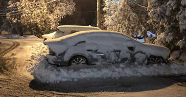 Cars covered in snow at the Chappaqua Railroad Station
