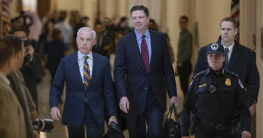 Former FBI Director James Comey, with his attorney, David Kelley, left, arrive to testify under subpoena behind closed doors before the House Judiciary and Oversight Committee on Capitol Hill in Washington, Friday, Dec. 7, 2018.