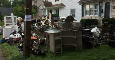 New Jersey neighborhoods devastated by flooding begin clean up