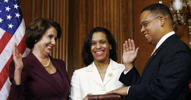 U.S. Rep. Keith Ellison (D-MN) (R) takes his oath of office by swearing on a Koran during a ceremonial swearing in with Speaker of the House Nancy Pelosi.