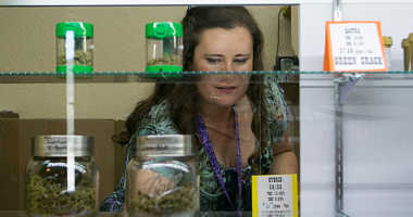 Owner of the Sumpter Nugget dispensary, Jenny Long restocks inventory July 2, 2017 in Sumpter, Oregon.