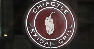 A sign marks the location of a Chipotle restaurant.