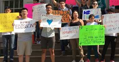 A crowd rallies in support of a New York City cabbie awaiting deportation.