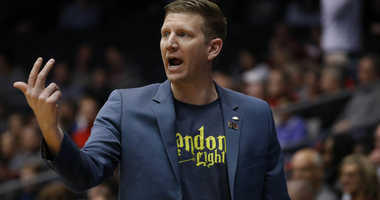 """North Dakota State coach Dave Richman wears a """"Landon's Light"""" T-shirt during the First Four round of the 2019 NCAA Tournament."""