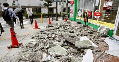 Debris of damaged walls are scattered following an earthquake, in Ibaraki, Osaka, Monday, June 18, 2018.