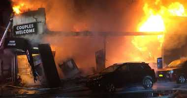 A five alarm fire ripped through businesses in Sunnyside.