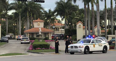A man shouting about Donald Trump entered the president's south Florida golf course early Friday, draped a flag over a lobby counter and exchanged fire with police before being arrested, police said.