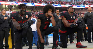 San Francisco 49ers outside linebacker Eli Harold (58), quarterback Colin Kaepernick (7) and free safety Eric Reid (35) kneel in protest during the playing of the national anthem before a NFL game