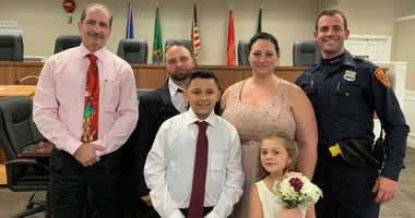 Cop drives couple to wedding