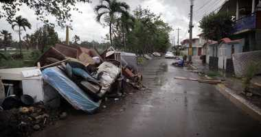 Debris left over from Hurricane Maria as well as furniture, appliances and washed out vehicles, litter a street in Toa Baja Puerto Rico, on October 12, 2017.