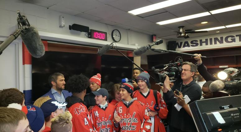 Divyne Apollon II and the Metro Maple Leafs pose for photos with Alex Ovechkin