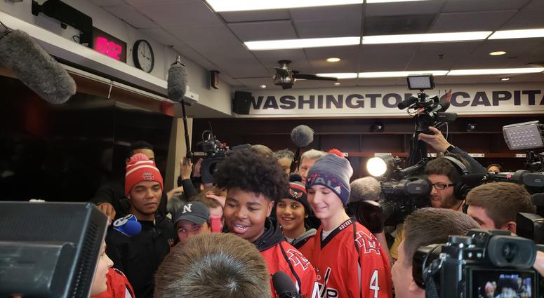 Divyne Apollon II of the Metro Maple Leafs meets his hockey heroes, the Washington Capitals