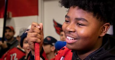 13-year-old Divyne Apollon II of the Metro Maple Leafs meets Devante Smith-Pelly and the Washington Capitals