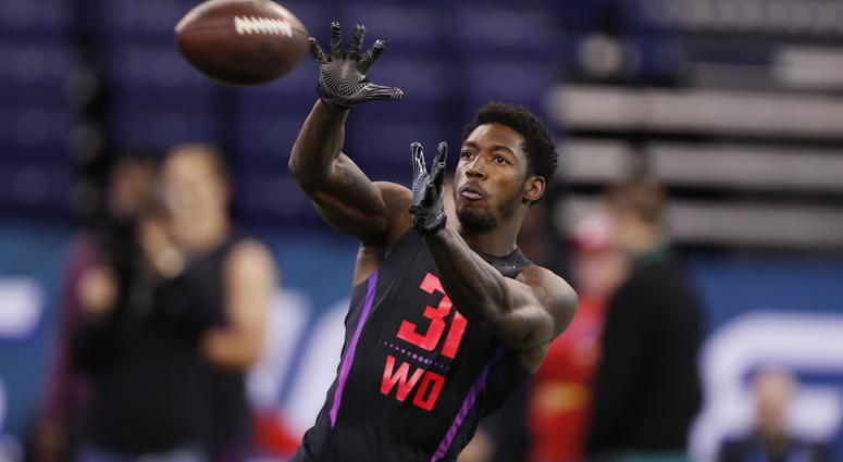 Calvin Ridley catches a pass at the NFL Combine