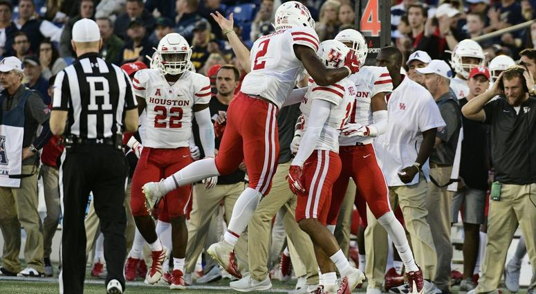 Oct 20, 2018; Annapolis, MD, USA; Houston Cougars defensive back Deontay Anderson (2), cornerback Alexander Myres (18) and defensive back Gleson Sprewell (21) celebrate after stopping Navy Midshipmen on fourth down during the fourth quarter at Navy-Marine
