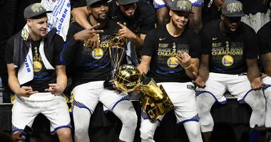 Klay Thompson (left) and forward Kevin Durant (middle) and guard Stephen Curry (right) celebrate after defeating the Cleveland Cavaliers in game four of the 2018 NBA Finals