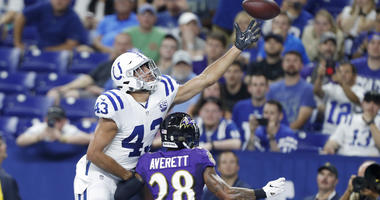 Aug 20, 2018; Indianapolis, IN, USA; Indianapolis Colts tight end Ross Travis (43) tries to make a catch against Baltimore Ravens cornerback Anthony Averett (28) during the third quarter at Lucas Oil Stadium. Mandatory Credit: Brian Spurlock-USA TODAY Spo