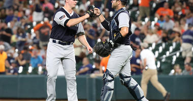 Aug 24, 2018; Baltimore, MD, USA; New York Yankees pitcher Zach Britton (53) is congratulated by catcher Austin Romine (28) after earning a save against the Baltimore Orioles at Oriole Park at Camden Yards. Mandatory Credit: Mitch Stringer-USA TODAY Sport