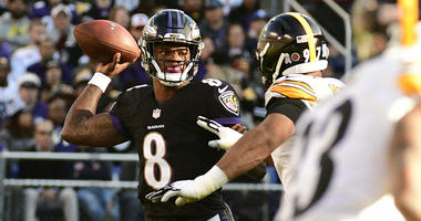 Nov 4, 2018; Baltimore, MD, USA; Baltimore Ravens quarterback Lamar Jackson (8) throws as Pittsburgh Steelers defensive end Cameron Heyward (97) applies pressure during the third quarter at M&T Bank Stadium. Mandatory Credit: Tommy Gilligan-USA TODAY Spor