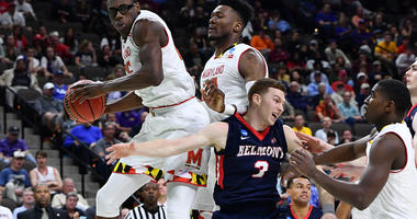 Mar 21, 2019; Jacksonville, FL, USA; Maryland Terrapins forward Jalen Smith (left) grabs a rebound against forward Bruno Fernando (middle) and Belmont Bruins guard Dylan Windler (3) during the second half in the first round of the 2019 NCAA Tournament at